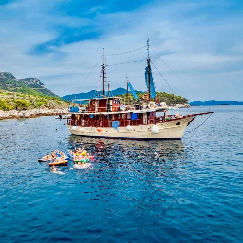 Busabout Croatia sailing boat with people swimming